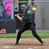 Jon Behm - The Morning Journal<br /> Elyria Catholic seniro Olivia Madera passes on a high pitch during the bottom of the fourth inning against Massillon Tuslaw in a Division III Massillon Region semifinal on May 24.