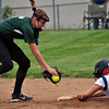 Jon Behm - The Morning Journal<br /> Massillon Tuslaw senior Cali Frascone (4) slides into second before the tag of Elyria Catholic senior Sam Filiaggi during the top of the first inning of a Division III Massillon Region semifinal on May 24.