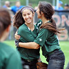 Jon Behm - The Morning Journal<br /> Elyria Catholic freshman center fielder Stephanie Griffin, left, gets a hug from sister Kaylie Griffin after Stephanie made a diving catch to end the top of the eighth inning against Massillon Tuslaw in a Division III Massillon Region semifinal on May 24.