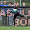 Jon Behm - The Morning Journal<br /> Elyria Catholic freshman Stephanie Griffin makes a diving catch during the top of the eighth inning against Massillon Tuslaw in a Division III Massillon Region semifinal on May 24.