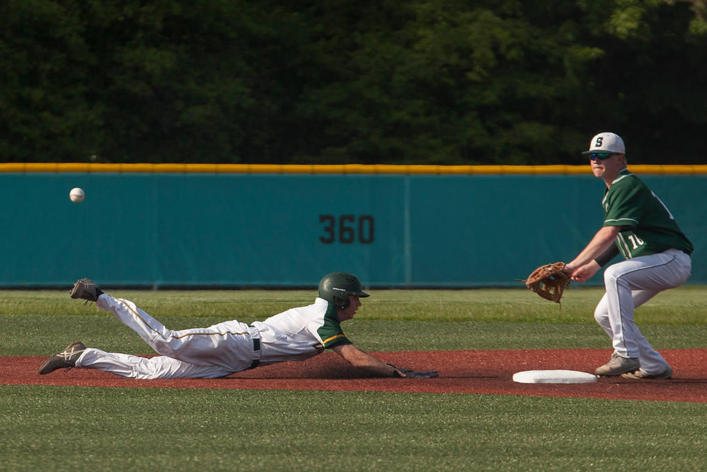 . Jen Forbus - The Morning Journal<br> Amherst\'s Ryan Glowacki dives back to second against Strongsville on May 24.