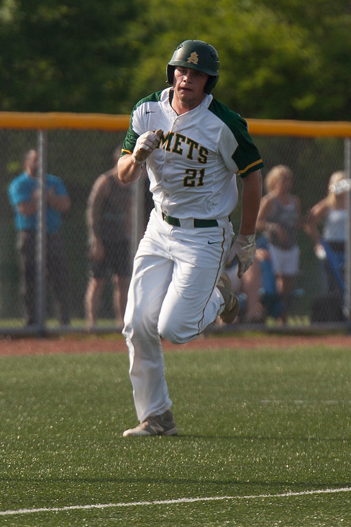 . Jen Forbus - The Morning Journal<br> Amherst\'s Jacob Lezon rounds third and heads home for Amherst\'s only score of the game against the Strongsville Mustangs on May 24.