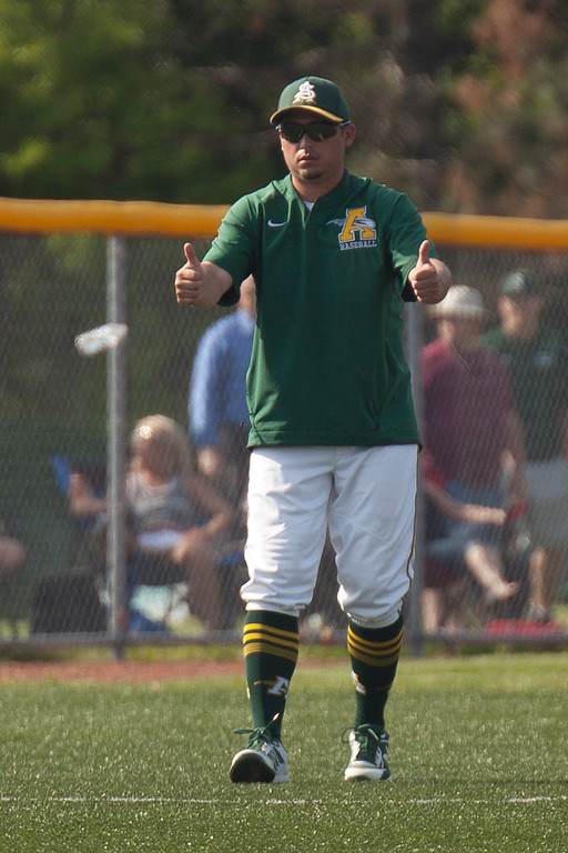 . Jen Forbus - The Morning Journal<br> Amherst coach Matt Rositano has thumbs up for his team against Strongsville on May 24.