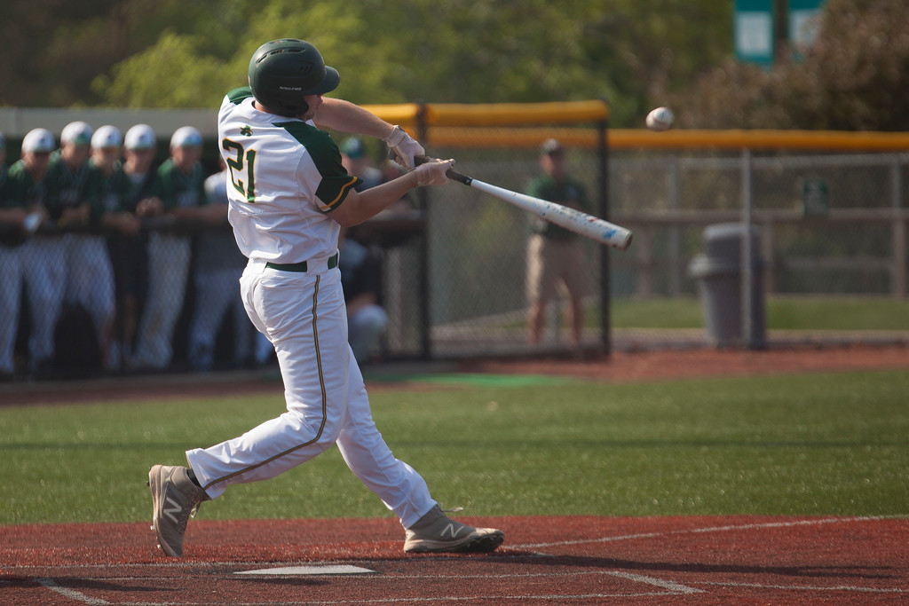 . Jen Forbus - The Morning Journal<br> Amherst\'s Jacob Lezon gets a piece of a pitch during the Comets\' regional semifinal contest against the Strongsville Mustangs on May 24.