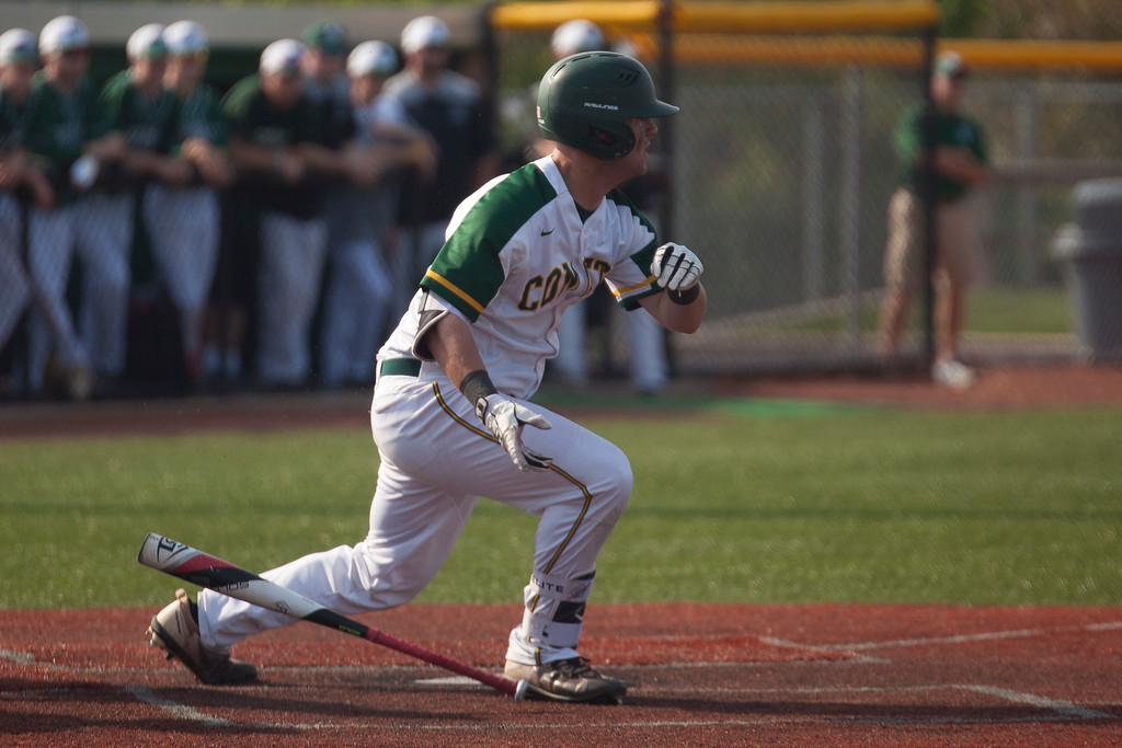 . Jen Forbus - The Morning Journal<br> Amherst\'s Kyle Dalzell heads for first after getting his bat on the ball against Strongsville on May 24.