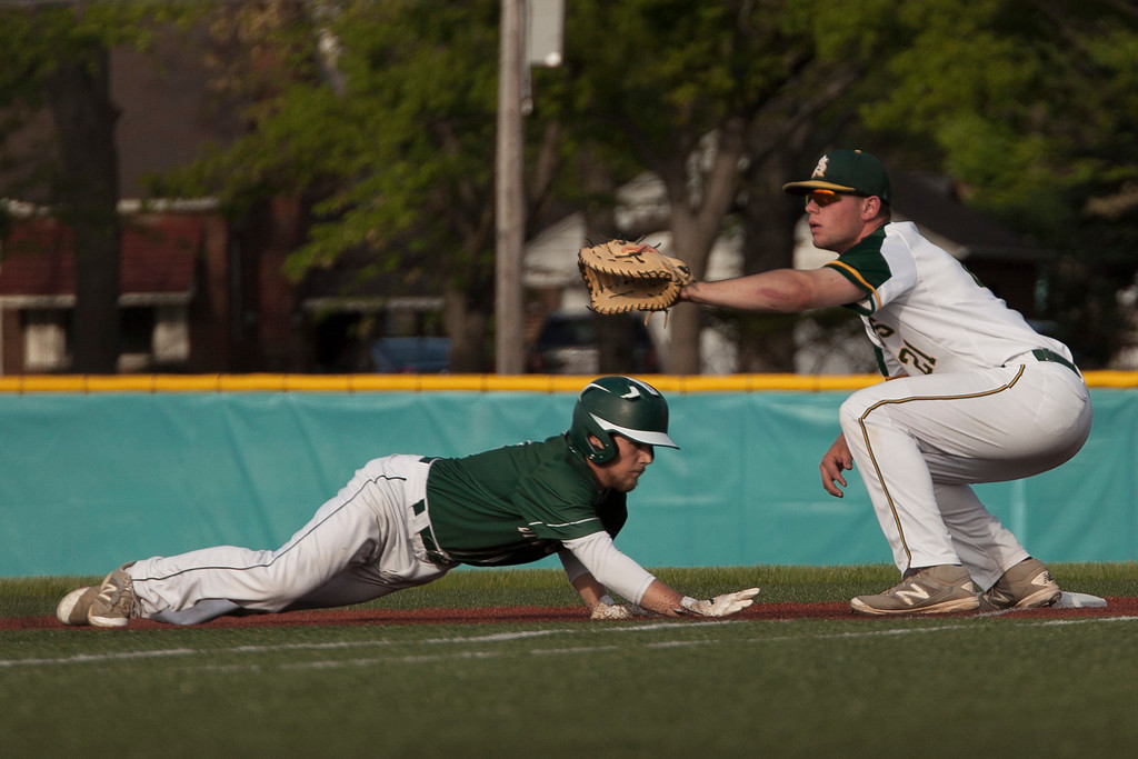 . Jen Forbus - The Morning Journal<br> Amherst first baseman Jacob Lezon keeps Strongsville baserunner Giovanni Lombardo close to the bag on May 24.