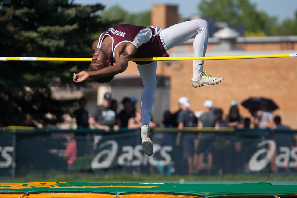 . Jen Forbus - The Morning Journal<br> Rocky River\'s Daishaun Hill arches over the crossbar in the boys high jump on May 25.