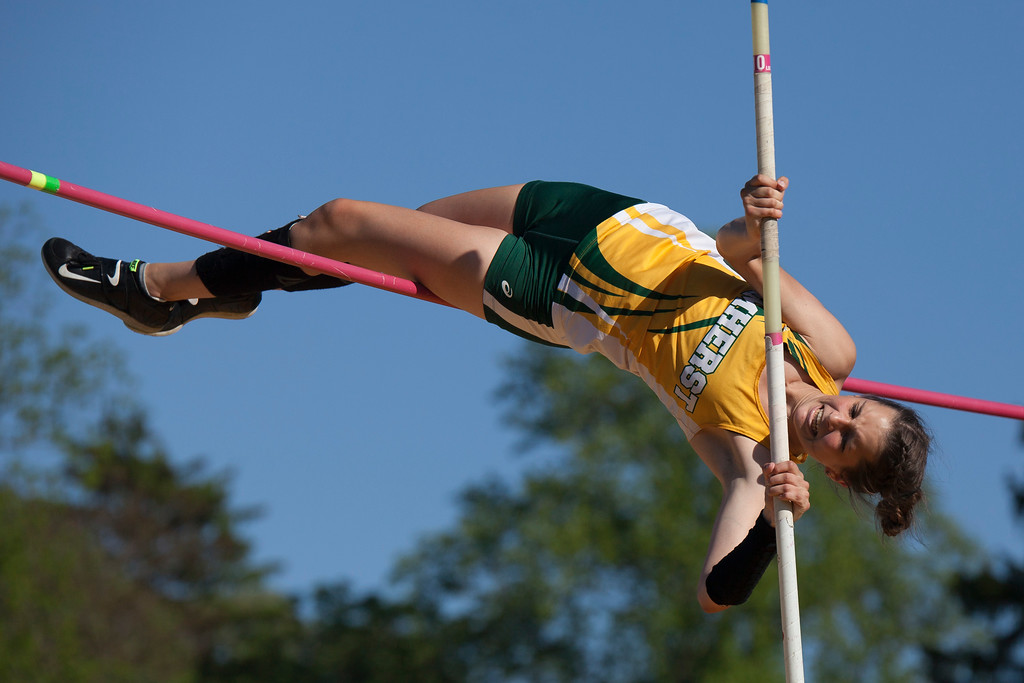 . Jen Forbus - The Morning Journal<br> Sydney Walker of Amherst tries to clear the crossbar in the girls pole vault on May 25.