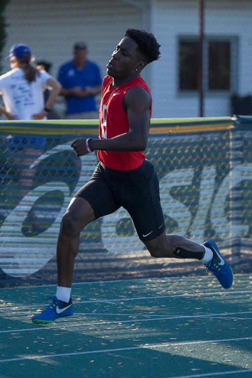 . Jen Forbus - The Morning Journal<br> Elyria\'s Jayvion Benton powers through the boys 400-meter dash on May 25.