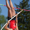 Jen Forbus - The Morning Journal<br> Elyria's Sarah Schneider hoists herself up to clear the bar in the girls pole vault on May 25.