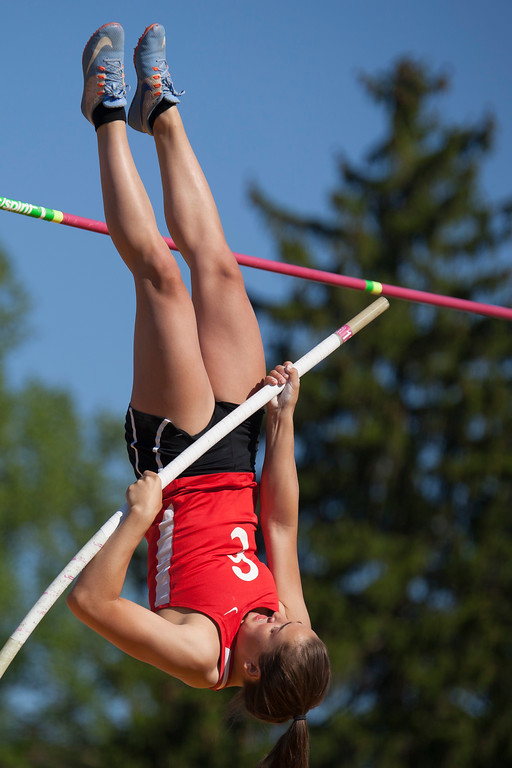 . Jen Forbus - The Morning Journal<br> Elyria\'s Sarah Schneider hoists herself up to clear the bar in the girls pole vault on May 25.
