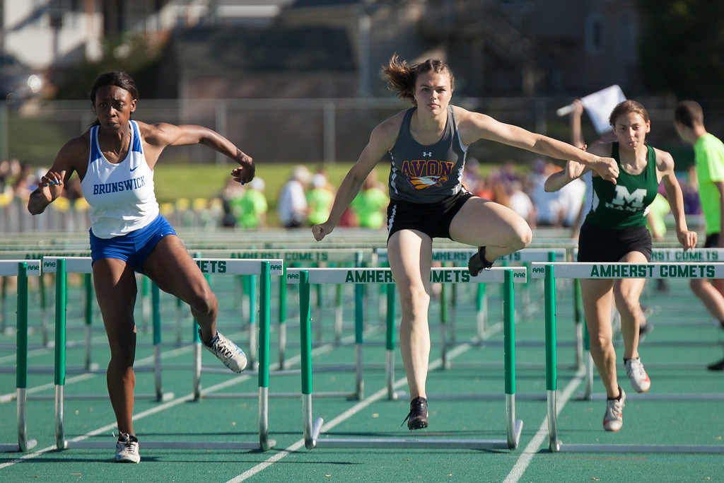 . Jen Forbus - The Morning Journal<br> Avon\'s Kamryn Sharer jumps her final hurdle in the girls 100 hurdles on May 25.