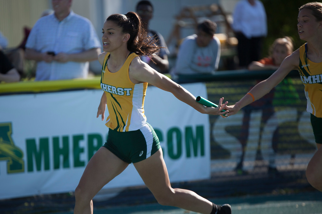 . Jen Forbus - The Morning Journal<br> Amherst\'s 4x200 relay hands off the baton at the Amherst regional track meet May 25.