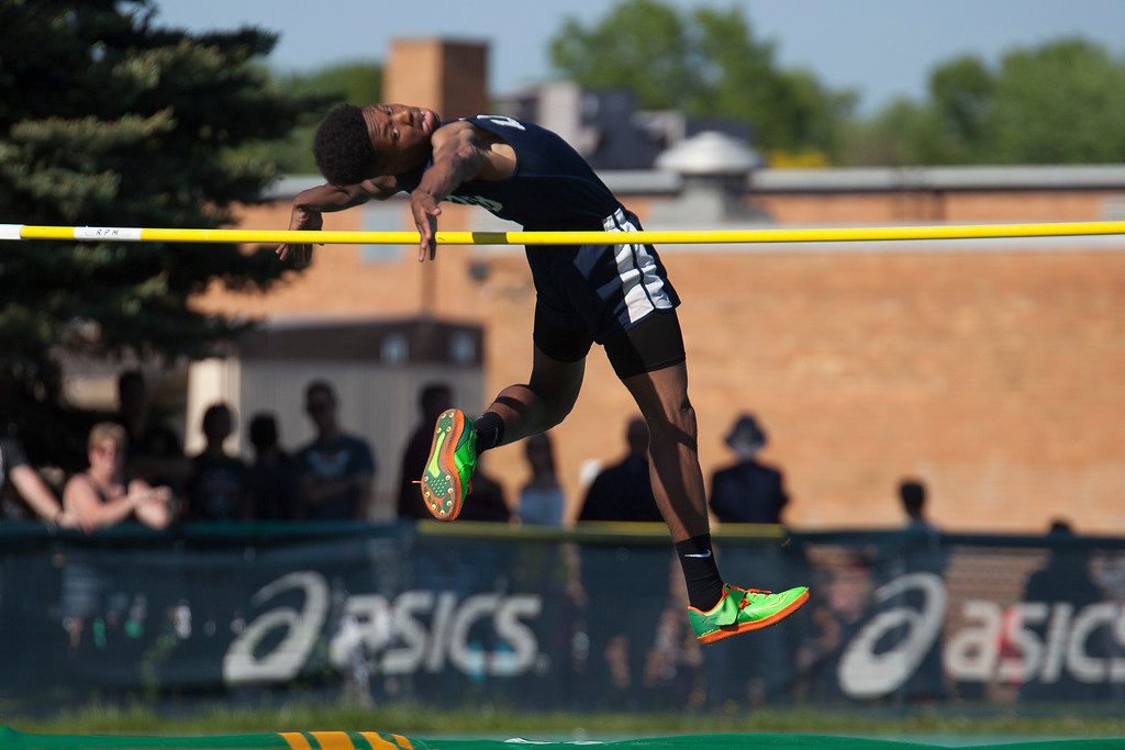 . Jen Forbus - The Morning Journal<br> Karrengton Wade of Lorain clears the bar in the boys high jump on May 25.