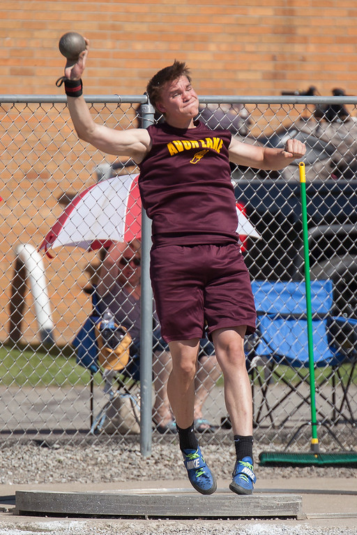 . Jen Forbus - The Morning Journal<br> Avon Lake\'s Justin Wirtz tosses the shot put in the regional track meet at Amherst on May 25.