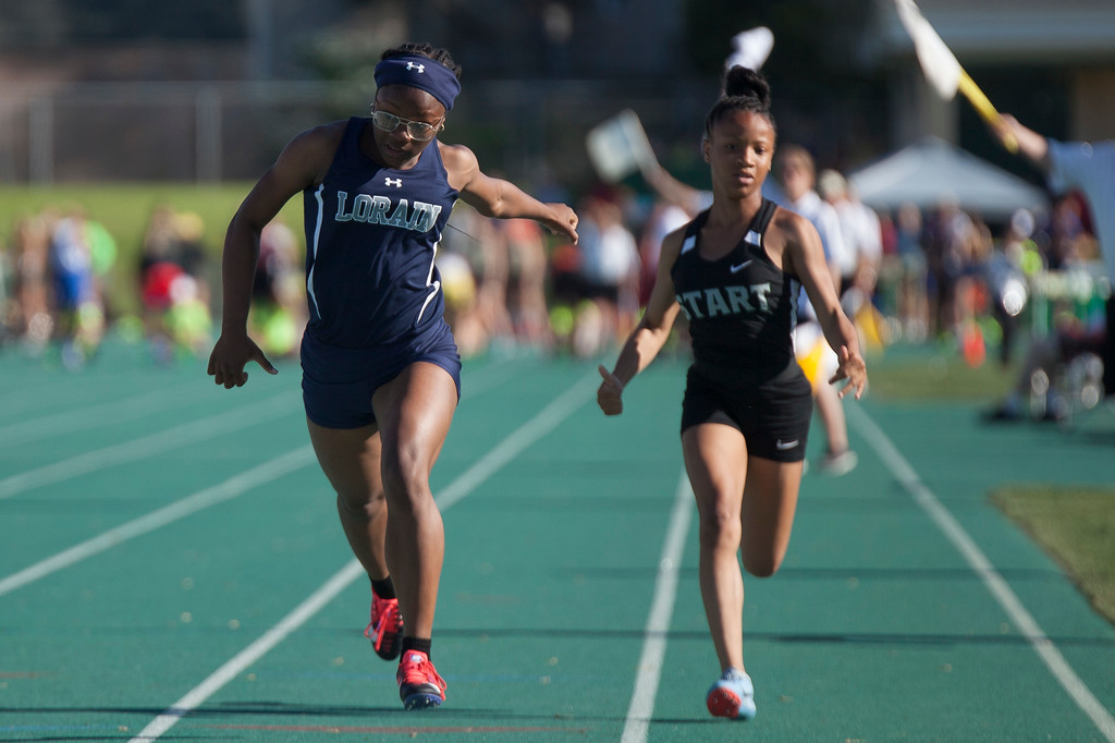 . Jen Forbus - The Morning Journal<br> Lorain\'s Mikiya Hermon crosses the finish line in the girls 100-meter dash on May 25.