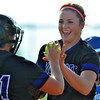 Jon Behm - The Morning Journal<br /> Keystone catcher Destiny Weber, left, hands pitcher Lauren Shaw the ball following her strikeout to end the Wildcats' 5-0 win over Defiance in a Bucyrus Region semifinal on May 25 at Bucyrus High School. Defiance junior Zariah Scott is pictured in the background.