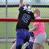 Jon Behm - The Morning Journal<br /> Keystone junior center fielder Paige Harltley makes a leaping catch to save a home run during the bottom of the first inning against Definace in a Bucyrus Region semifinal on May 25 at Bucyrus High School.