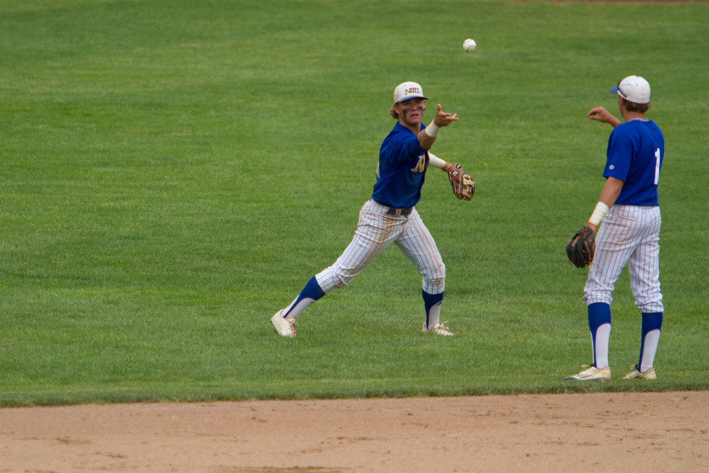 . Michael Johnson - The News-Herald NDCL\'s Sam Frontine flips the ball to his teammate, Jake Marut (1) during the Division 2 Regional Tournament against Tallmadge in Hudson on May 26.  Tallmadge defeated NDCL 3-1.