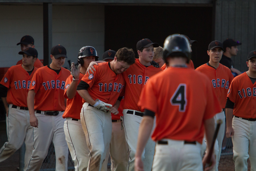 . Michael Johnson - The News-Herald Chagrin Falls players console one another after losing to Canfield 2-0 in the Hudson Regional Semifinal on May 26.