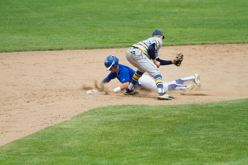 . Michael Johnson - The News-Herald NDCL\'s Jake Marut slides into second base during the Division 2 Regional Tournament against Tallmadge in Hudson on May 26.  Tallmadge defeated NDCL 3-1.