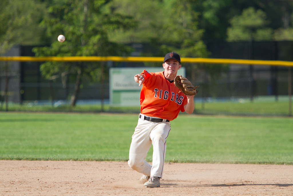 . Michael Johnson - The News-Herald Chagrin Falls\' Kyle Zaluski makes a throw to first base during the Hudson Regional Semifinal against Canfield on May 26.  Canfield defeated Chagrin Falls 2-0.