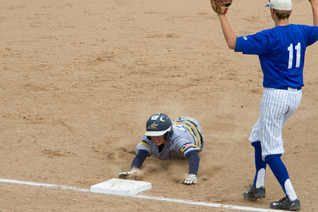 . Michael Johnson - The News-Herald Tallmadge\'s Jake Rensel slides into third base safely during the Division 2 Regional Tournament in Hudson on May 26.  Tallmadge defeated NDCL 3-1.