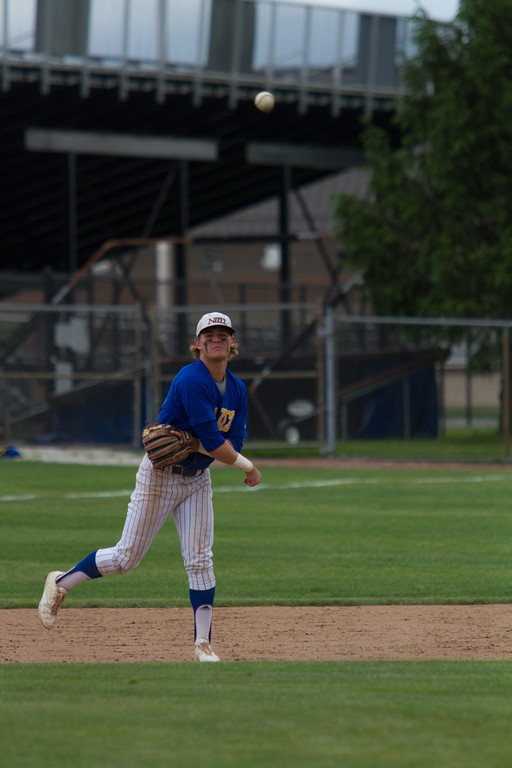 . Michael Johnson - The News-Herald NDCL\'s Sam Frontine makes a throw to first during the Division 2 Regional Tournament against Tallmadge in Hudson on May 26.  Tallmadge defeated NDCL 3-1.