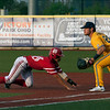 Jen Forbus - The Morning Journal<br> Miami baserunner Cristian Tejada dives back to first where Kent State's Michael Turner is carefully covering the bag on May 26.