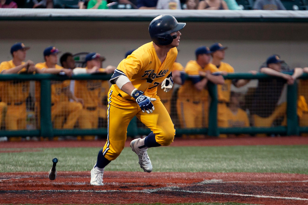 . Jen Forbus - The Morning Journal<br> Kent State\'s Reilly Hawkins (Chardon) keeps his eye on the ball as he takes off for first against Miami during the MAC Championship game at Sprenger Stadium in Avon on May 26.