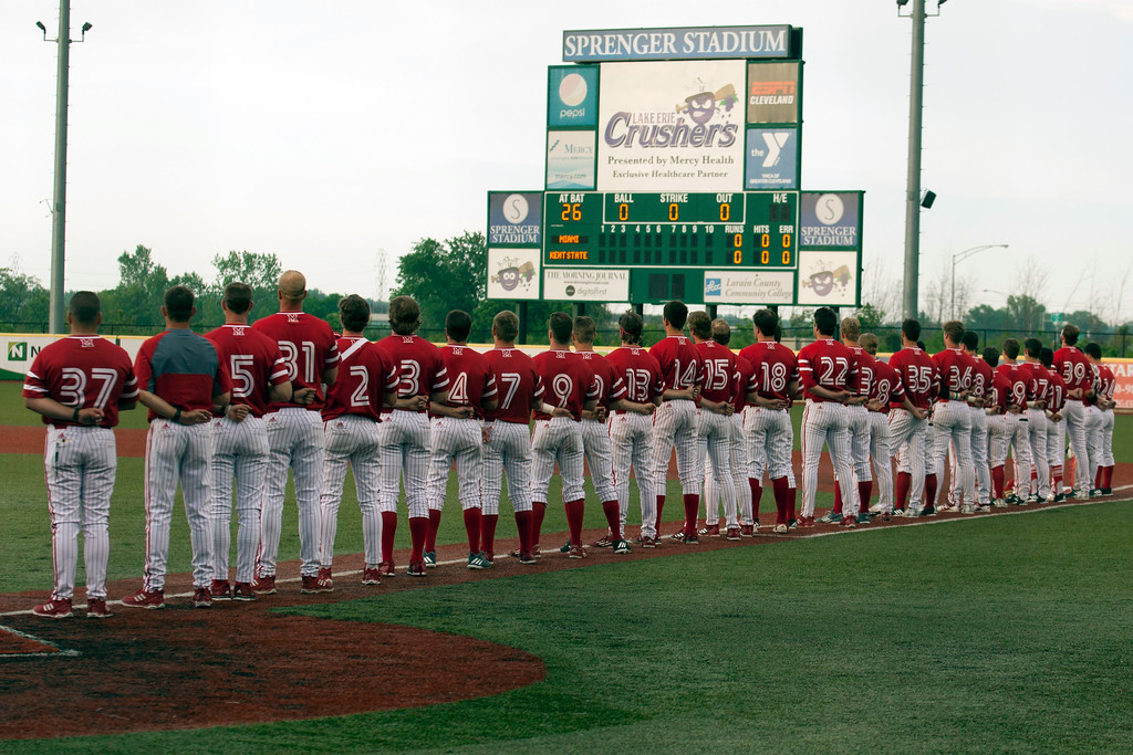. Jen Forbus - The Morning Journal<br> The Miami Red Hawks stand for the National Anthem prior to their championship game versus the Kent State Golden Flashes at Sprenger Stadium on May 26.