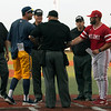 Jen Forbus - The Morning Journal<br> The coaches for Kent and Miami meet with the umpires prior to the start of the MAC Championship game at Sprenger Stadium on May 26.