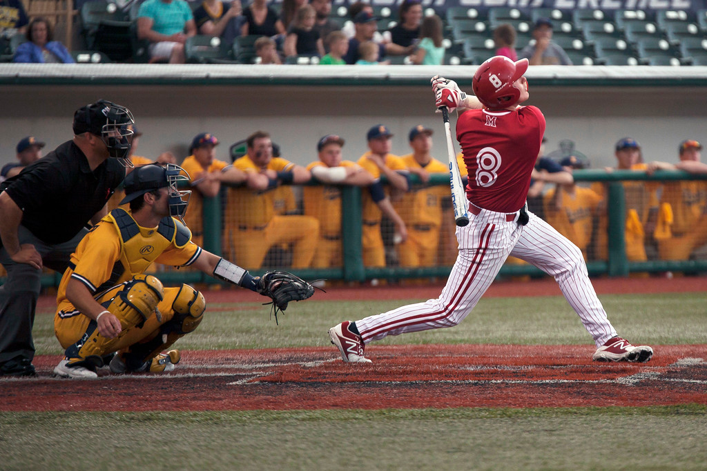 . Jen Forbus - The Morning Journal<br> Miami\'s Landon Stephens watches his hit in the Red Hawks\' game against the Kent State Golden Flashes on May 26.