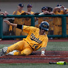Jen Forbus - The Morning Journal<br> Josh Hollander slides into home for a Kent State run againt Miami on May 26.