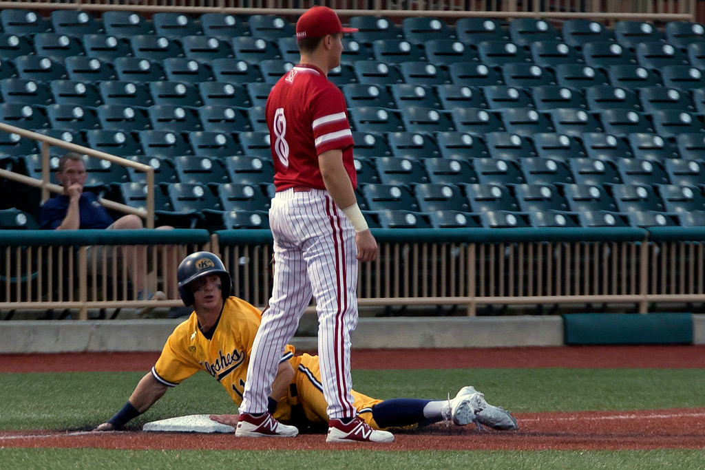 . Jen Forbus - The Morning Journal<br> Kent\'s Mason Mamarella slides into third while Miami third baseman Landon Stephens waits on the throw on May 26.
