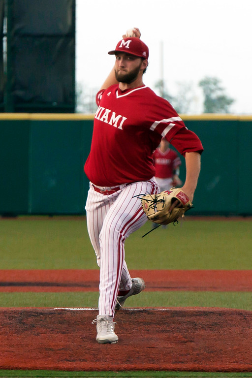 . Jen Forbus - The Morning Journal<br> Miami starter Spencer Mraz delivers against Kent State in the MAC Championship game at Sprenger Stadium on May 26.
