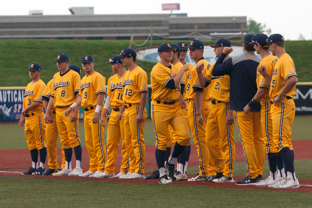 . Jen Forbus - The Morning Journal<br> Kent State\'s Collin Romel (Olmsted Falls) fist bumps his teammates during introductions for the MAC Championship game. The Golden Flashes played the Miami Red Hawks on May 26.