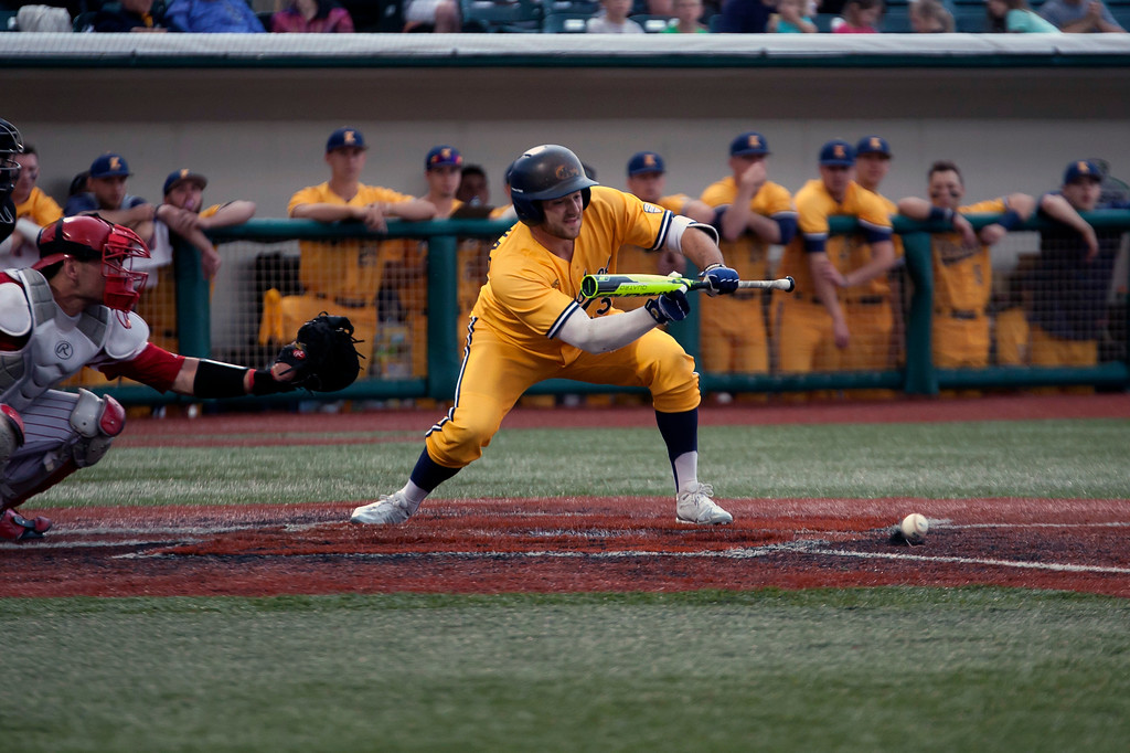 . Jen Forbus - The Morning Journal<br> Kent State\'s Nick Kanavas lays down a bunt against Miami during the MAC Championship game at Sprenger Stadium on May 26.