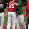 Jen Forbus - The Morning Journal<br /> Amherst senior Evan Shawver get a hug from coach Matt Rositano after being named the 2018 Lorain County Mr. Baseball during the Lorain County Senior All-Star games at Oberlin College on May 26.