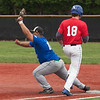 Jen Forbus - The Morning Journal<br /> Matt Caraballo of Columbia makes the out for the Blue team against Ian Ashby of Lake Ridge during the Lorain County Senior All-Star Game at Oberlin College on May 26.
