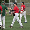 Jen Forbus - The Morning Journal<br /> After a good inning on the mound for the red team, Cole Bramhall of Lake Ridge gets a fist bump from coach Matt Rositano during the Lorain County Senior All-Star Game at Oberlin College on May 26.