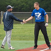 Jen Forbus - The Morning Journal<br /> Cade Myers of Keystone is congratulated by his coach during the Lorain County Senior All-Star Game at Oberlin College on May 26.