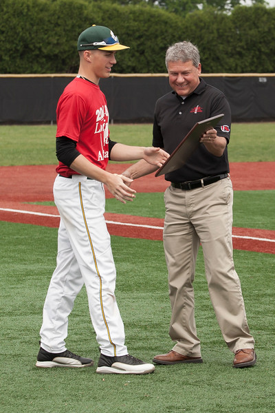Jen Forbus - The Morning Journal<br /> Amherst senior Evan Shawver is presented with the 2018 Lorain County Mr. Baseball plaque by Gregory Finton during the Lorain County Senior All-Star games at Oberlin College on May 26.