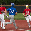Jen Forbus - The Morning Journal<br /> North Ridgeville's Evan Truelson beats Avon Lake's Jacob Krukowski to the bag during the Lorain County Senior All-Star Game at Oberlin College on May 26.