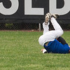Jen Forbus - The Morning Journal<br /> Despite a diving effort, Tristan Arno of Elyria isn't able to make the catch for the blue team during the Lorain County Senior All-Star Game at Oberlin College on May 26.