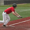 Jen Forbus - The Morning Journal<br /> Amherst's Cameron Karnik lays down a bunt during the Lorain County Senior All-Star Game at Oberlin College on May 26.