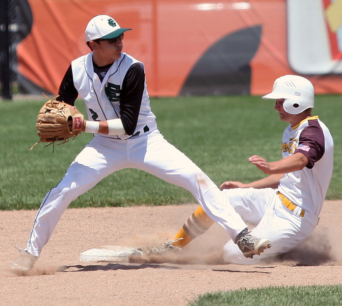 RANDY MEYERS THE MORNING JOURNAL  Elyria Catholic's James Rickard forces out Evan Reidenbach of Waynedale at second base.