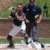 RANDY MEYERS THE MORNING JOURNAL    Elyria Catholic's Grant McClure slides safely into home as Waynedale catcher Aaron Spidell loses control of the ball.