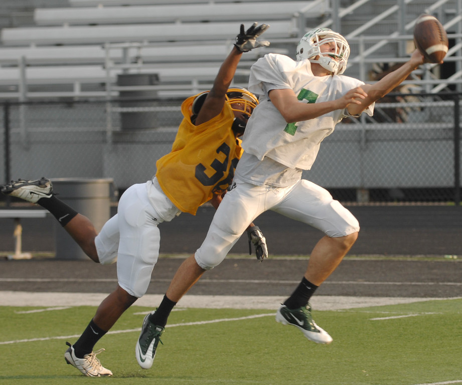 . News-Herald file Mayfield\'s Chuck Zavarella can\'t pull in pass defended by Euclid\'s John Jackson during Tuesday\'s blue team News-Herald Senior Bowl practice in Mentor.