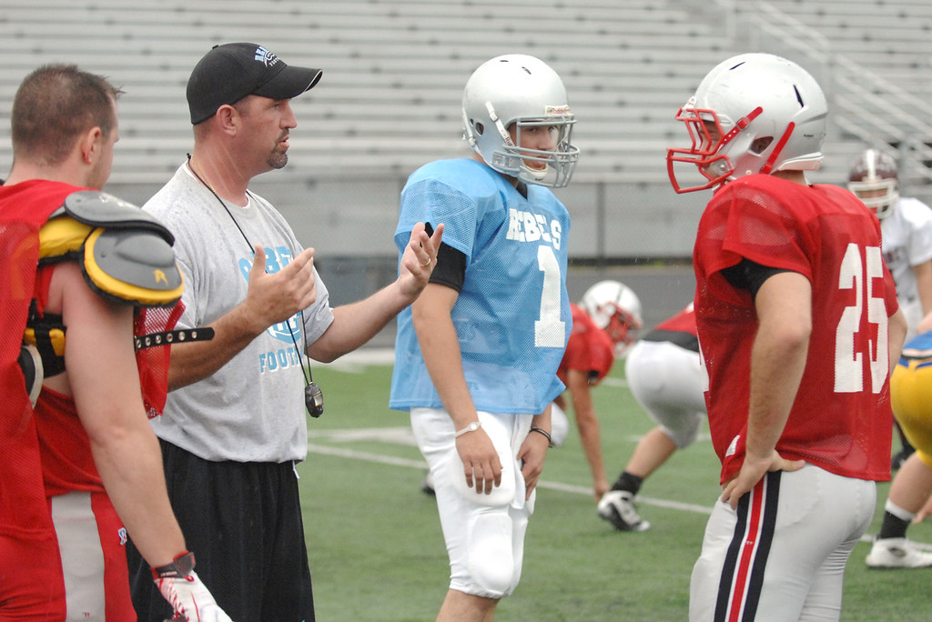 . News-Herald file White team coach Matt Duffy talks to players during Monday\'s practice including South quarterback